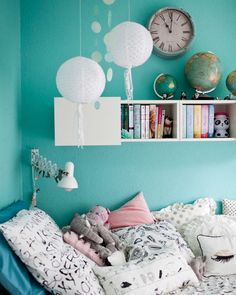 Make your bed a cosy spot to relax in with soft lighting and piles of pillows #IKEAIDEAS #IKEAFAMILYMAGAZINE