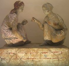 Capua (southern Italy), around 330-300 BC. Two girls playing 'knucklebones'.    This game (similar to jacks) was popular amongst children and young women in ancient Greece- the players would throw the knucklebones into the air, and then try to catch as many as they could on the back of their hands. The knucklebones were made from the anklebones of sheep or goats.    British Museum, London