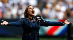 """am woman, hear me roar! singing our national anthem for grand final today wearing """"I am not afraid of deep water """" dress!"""