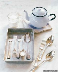 A simple chemical reaction causes tarnish to disappear naturally. Place sterling or plated silver in an aluminum pan -- it must be aluminum. Sprinkle 1/2 to 1 cup baking soda over the silverware.