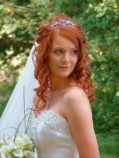 Curls with transparent long veil and crown #hot #sexy #hairstyles #hairstyle #hair #long #short #medium #buns #bun #updo #braids #bang #greek #braided #blond #asian #wedding #style #modern #haircut #bridal #mullet #funky #curly #formal #sedu #bride #beach #celebrity #simple #black #trend #bob #girls