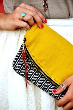 Casual clutch with yellow flap and zipper tassel