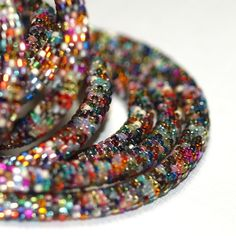 """Bead crochet rope, 54"""" long, made with about 6000 Japanese cylinder beads with metallic finishes.  $150"""