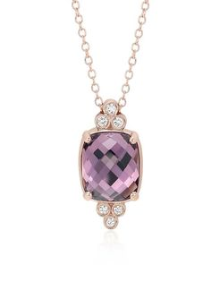 Truly unique, this gemstone pendant features a faceted cushion cabochon cut amethyst, accented with round brilliant cut diamonds.