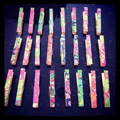 Old Lilly Pulitzer planner pages used to decorate clothespins for hanging photos. So cute! Need to make this now!