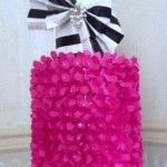 Sassy Cake Tutorial features how to make this adorable paper cake. Hot pink and white wrapping paper wraps two round hat boxes. Hot pink punched flowers fill the sides of the bottom cake while black satin ribbon bands are on the top tier and decorative paper bow. See blog how- to lizbushong.com
