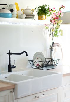 Love my three basin sink more but the faucet is super nice.