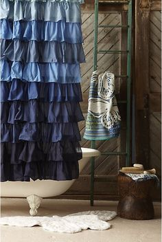 clawfoot tub, ruffles, and a rustic teal ladder <3