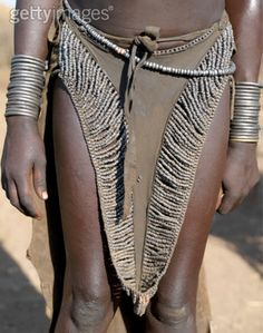 Africa | Leather skirt of a Nyangatom girl, richly decorated with metal beads.  Omo River, Southwest Ethiopia | ©Nigel Pavitt