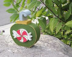 Red ornament on green block for Christmas Noel shelf by lisabees