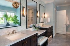 Transitional. Separate sinks, center makeup vanity. cool tones, espresso cabinets