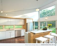 15 Classy Kitchen Windows for Your Home | Home Design Lover Like the window between cabinet and counter