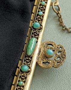 Vintage handbag frame detail. {via CountryLiving.com: A frame with faux-jade Stones and metal beads typifies dress-purse adorments of the 1900s}.