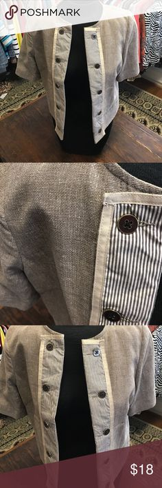 Short Sleeve Burlap Jacket with Striped Front Jacket looks like a burlap colored weave.. stripe down front with neat buttons that gives this look an edgy look.. pockets on both sides... short sleeve.. unconstructured.. great condition Andre Oliver Jackets & Coats