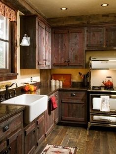 rustic kitchen - cabinets, beam over cabinets, farmers sink, concrete(?) counters.