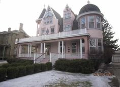 Historical charmer! Magnificent turn-of-the-century Victorian is located on a charming brick street in Racine's south side historic district. Features picturesque wrap-around porch and upper balcony, exquisite foyer with open staircase, spacious kitchen with two pantries, parquet floors, stained and lead glass windows, gorgeous red birch woodwork, 3 fireplaces, 6BR & 3-car garage. Truly a gem. Seller will pay up to $500 Home Warranty to owner-occupant buyers if requested in offer.