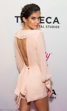 Sara Sampaio; The garment featured a backless cutout as a ribbon tied around the back...