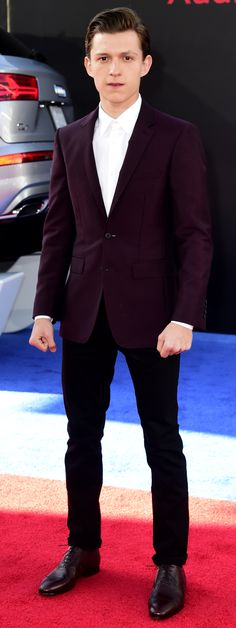 British actor Tom Holland on the red carpet at the Captain America Premiere in LA wearing Burberry tailoring