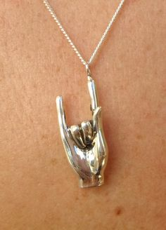 rock n' roll jewelry necklace hand pendant. A hand necklace from solid sterling silver hand carved using the lost wax method. Size: 25mm/1 inch high Width: 11mm/0.4 inches