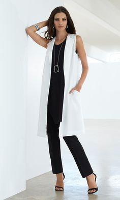 Black Label - The Midi Vest The season's newest length takes shape in this open topper. Put over an ensemble of solid black.