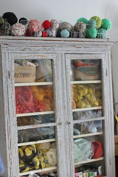 yarn storage- closed cabinets keep dust and moths out, windows for admiring yarn :)