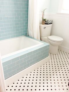 What a cool idea. (Vapor Glass Subway Tile Bathtub Surround)