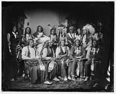 Red Cloud and other Souix created between 1865 and 1880  Standing - Red Bear, Young Man Afraid of his Horse, Good Voice, Ring Thunder, Iron Crow, White Tail, Young Spotted Tail. Seated - Yellow Bear, Red Cloud, Big Road, Little Wound, Black Crow by Matthew Brady Studio