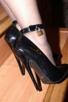 I'd keep that lock on her shoes until she'd been in them for hours. Her reward would be a lengthy foot massage. AFTER I sniffer her stockinged toes dry