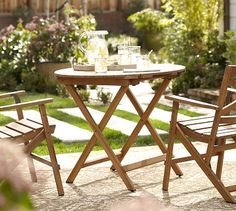 For mom/dad porch: Hampstead Teak Round Folding Bistro Table - Honey #potterybarn