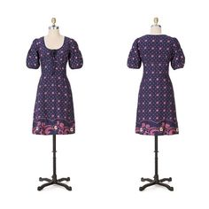 """Anthro 'CARLOTA DRESS' Violets large and small pepper this uplifting shift by Maeve. Three glossy buttons adorn an empire waist.  Ties at neckline Side zip Cotton Machine wash 37.5""""L Anthropologie Dresses"""