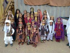 Baloch Kids in Cultural Dress with #Pakistan Flag on their face #Balochistan