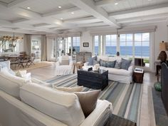 The quintessential beachfront home is decorated with a light color scheme.