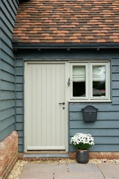 Border Oak - Painted softwood window and door contrasting with the gorgeous colour of the weatherboarding on a new build barn. Back door. House Cladding, Timber Cladding, Exterior Cladding, Weatherboard Exterior, Cladding Ideas, Stucco Exterior, Exterior Homes, Wall Exterior, Craftsman Exterior