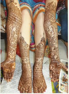 Beautiful wedding walas mehndi design henna on Indian or Pakitsani bride's arms& legs for a hindu wedding