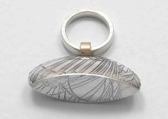 sterling silver ring with etched and oxidised hollow bell, 9ct gold detail