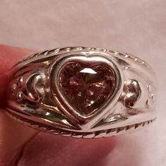 Vintage 925 Sterling Heart Ring w Pink Tourmaline Beautiful Sterling Silver 925 large vintage heart ring with brilliant cut Pink Tourmaline (October Birth stone) Vintage . Condition: Pre-Owned, Good, Wear Consistent w Age. Thank You for visiting BlackBeards Lost Treasure of Iowa All Treasures are Pre owned/used, examined, & researched (5>=90 hrs). We have spent hours searching the USA for our Treasures. Most Treasures are a rare find and can not be replaced. Our Treasures were all pre-loved…