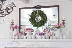 Lovely white, French cottage mantle- also love that wreath over the mirror