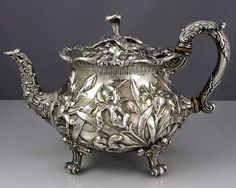 silver footed tea pot, c. 1903 by S Kirk & Son Co with chased irises all around the body and lid.Sterling silver footed tea pot, c. 1903 by S Kirk & Son Co with chased irises all around the body and lid. Silver Teapot, Silver Plate, Vintage Silver, Antique Silver, Cafetiere, Bronze, Chinese Tea, Silver Spoons, Tea Service