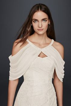 Add a unique accent to your wedding dress with delicate pleated chiffon sleeves. Punctuated by pearls at the neckline, this topper pairs perfectly with strapless dresses.  Polyester  Button closure  Imported