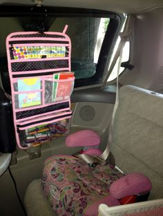 Pack toiletry bags full of fun activities for a road trip & hang in car next to each child.