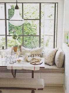 i think i want a couch by our big window in our nook, and a simple coffee table?!