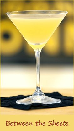 Between-the-sheets-cocktail: A strong and provocative drink… Ingredients 1 oz brandy 1 oz cointreau 1 tsp fresh lemon juice 1 oz light rum . Preparation Pour the ingredients into a mixing glass full of crushed ice. Shake and strain into a cocktail glass. Cocktail Glass, Cocktail Drinks, Cocktail Recipes, Refreshing Cocktails, Classic Cocktails, Holiday Cocktails, Bar Drinks, Yummy Drinks, Un Diner Presque Parfait