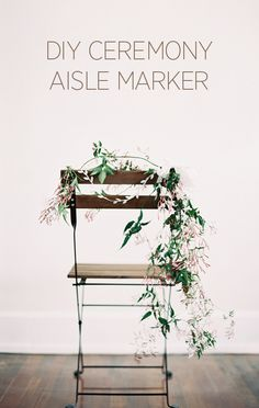 Um.... LOOOVE this aisle marker made from delicate vines and florals! What an incredibly pretty addition to any outdoor wedding!