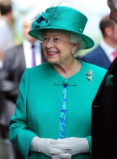 The Queen has hinted that she hopes the Royal baby arrives soon so she can go on holiday.