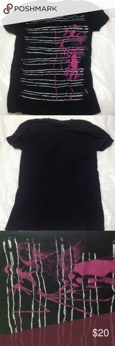 """Nightmare Before Christmas T-shirt Size M Black Nightmare Before Christmas T-shirt.  Size M.  Back of neck to bottom of shirt is approximately 24"""".  From armpit to armpit approximately 15 inches. Excellent condition.  Machine wash cold. Comes from a non smoking home.  Thanks for looking. Tops Tees - Short Sleeve"""