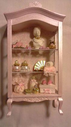 Dollhouse pink juwellery cabinet made by Jolanda Knoop