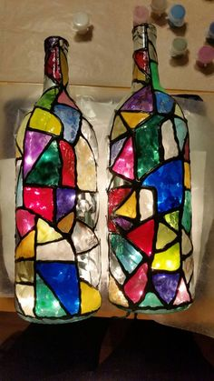 STAINED GLASS BOTTLES WITH LIGHTS (Available in 4 Great Designs)  We free hand draw out the lines on a 1.5 liter wine bottle and then paint