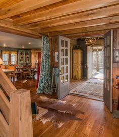 Timber Frame Home - Homestead Timber Frames  - Timber Frame Living Room - Timber Frame Entry - Handcrafted Timber Frames
