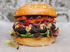 Veggie burger with all the trimmings, in burger bap, white background