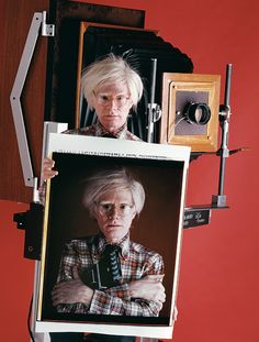 In 1980 Andy Warhol posed before the 20 x 24-inch Polaroid camera, a moment after he was photographed with his (much smaller) SX-70 tucked under his arm.